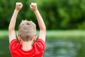 Child celebrating success or victory